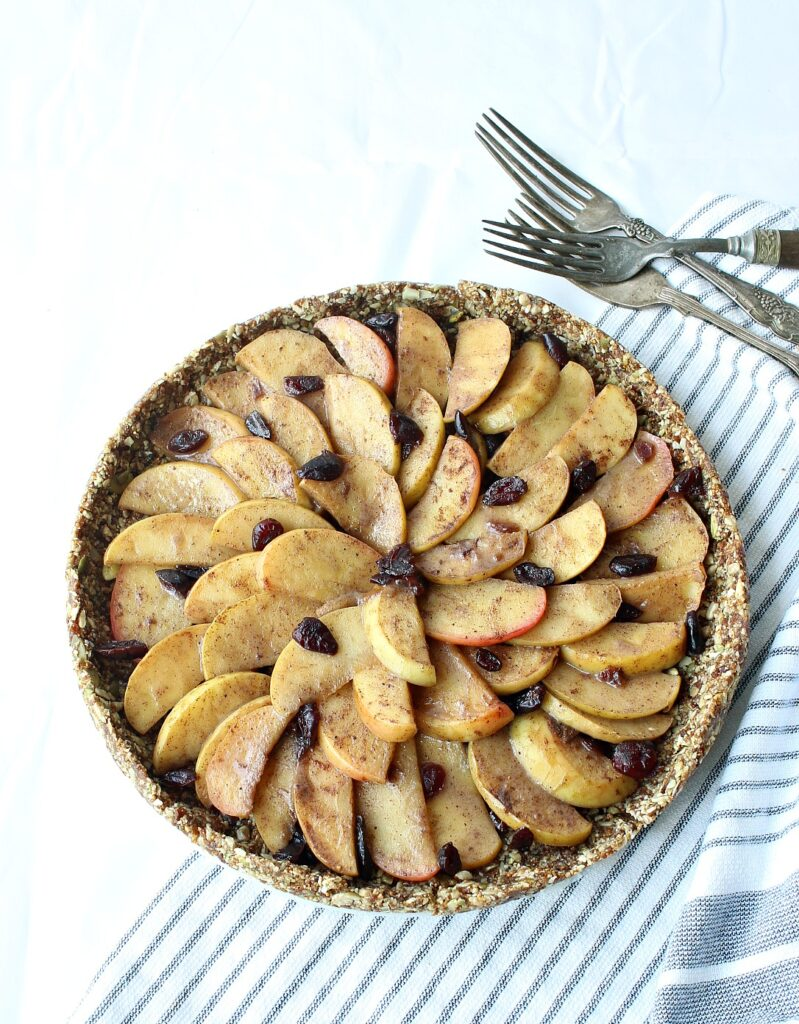 Gluten-free, no-bake apple pie, wrapped in a nutritious seed crust. Vegan, Nut-free, Paleo
