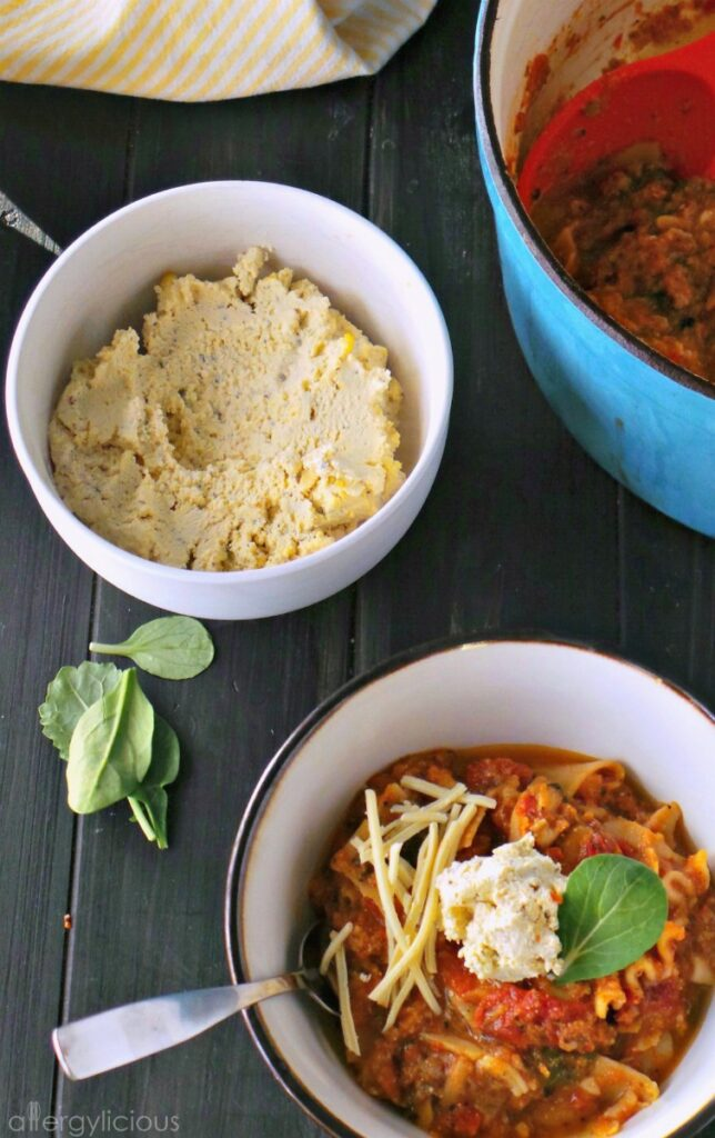 Vegan & GF One Pot Lasagna Soup, loaded with veggies, topped with spinach and fresh tofu ricotta.