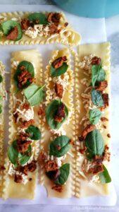 layering lasagna rolls