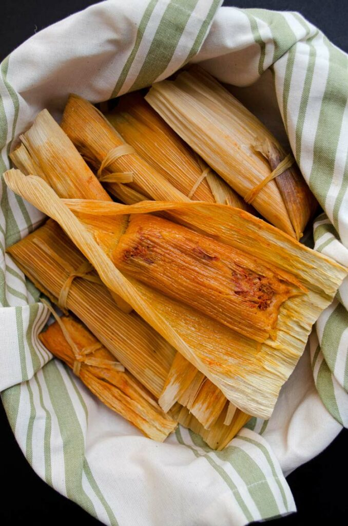 Delicious jackfruit tamales with a bit of heat from Red Chile flavored masa. Delicious & GF.