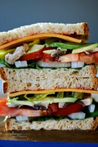 This monster of a sandwich is built for sharing and tiny mouths need not apply. OK, tiny mouths are welcome, but you may need to cut into smaller bites so you can devour this amazingly yummy dish. Get my recipe and find out what all the buzz is about when it comes to Canyon Bakehouse Gluten-free bread!..