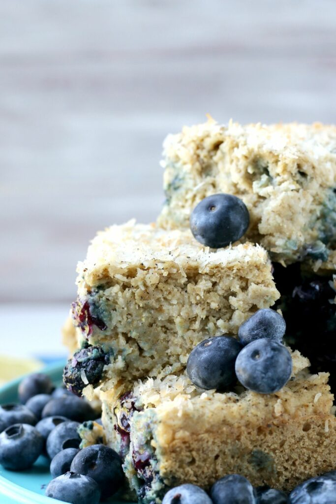 Each delightful bite of this Blueberry Lemon Snack Cake is bursting with fresh berries, lemon & sweet coconut.