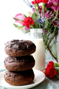 Chocolate donut stack with milk and flowers