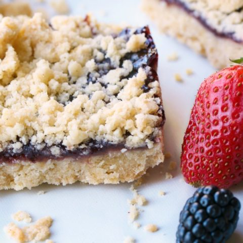 single raspberry shortbread bar with berries