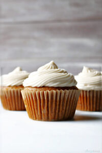 three pumpkin cupcakes