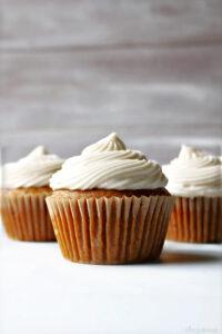 three pumpkin cupcakes