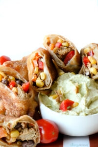 Tex Mex egg rolls with avocado dipping sauce