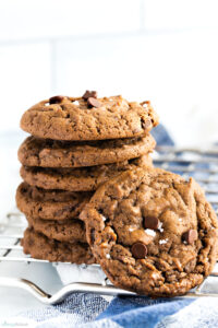 stacked pumpkin cookies with chocolate chips